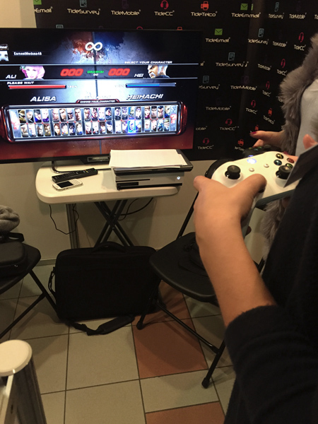 participants of job fairs play tekken at the Tide Software's stand